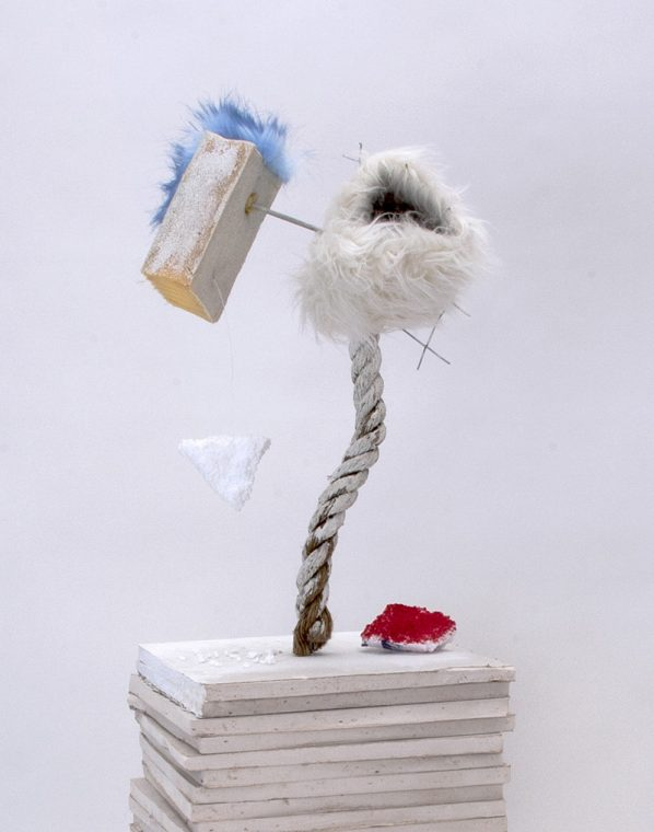 mixed media composition with fur, foam, and styrofoam on drywall pedestal