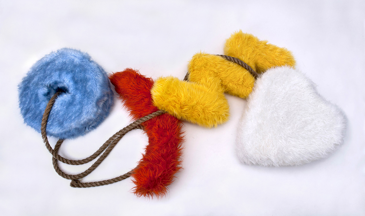 composition of four fur sculptures with manila rope