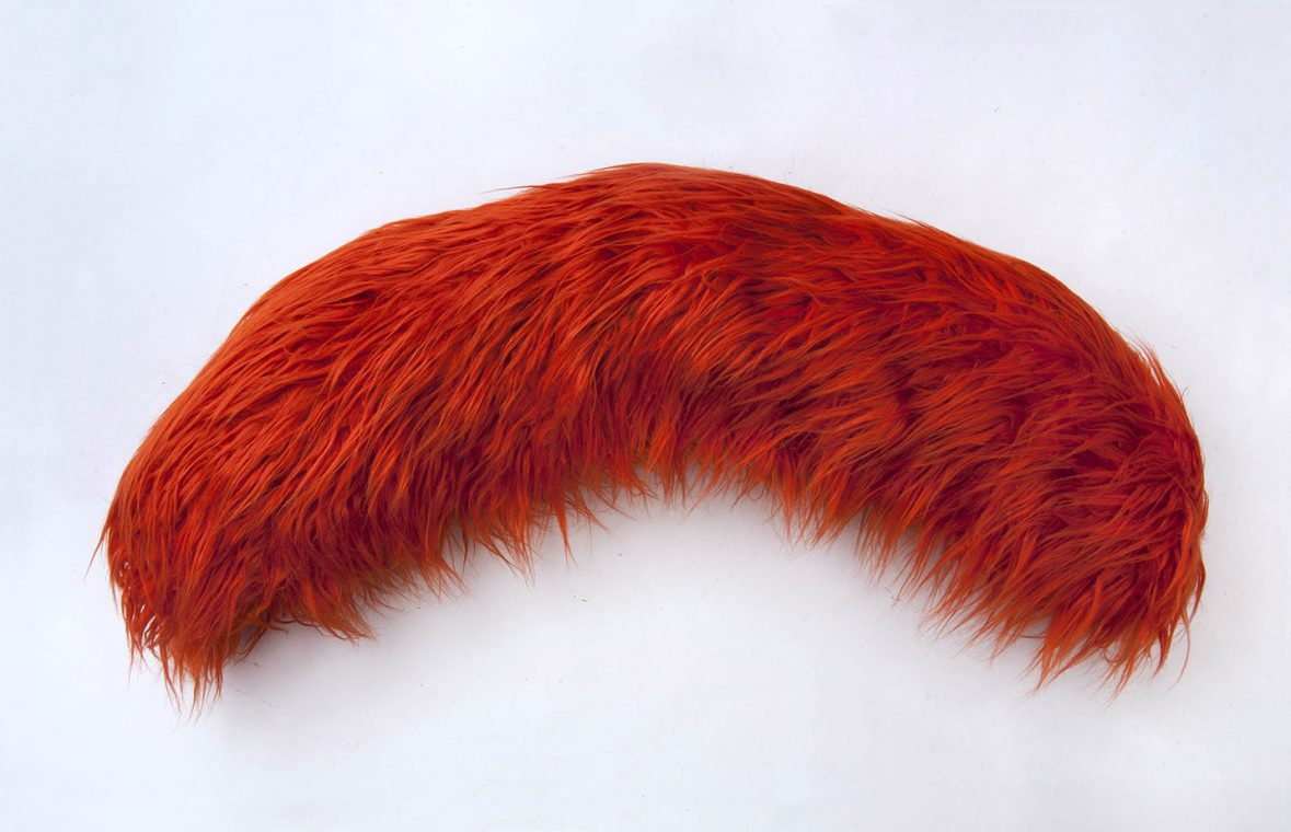 red fur brow wall sculpture