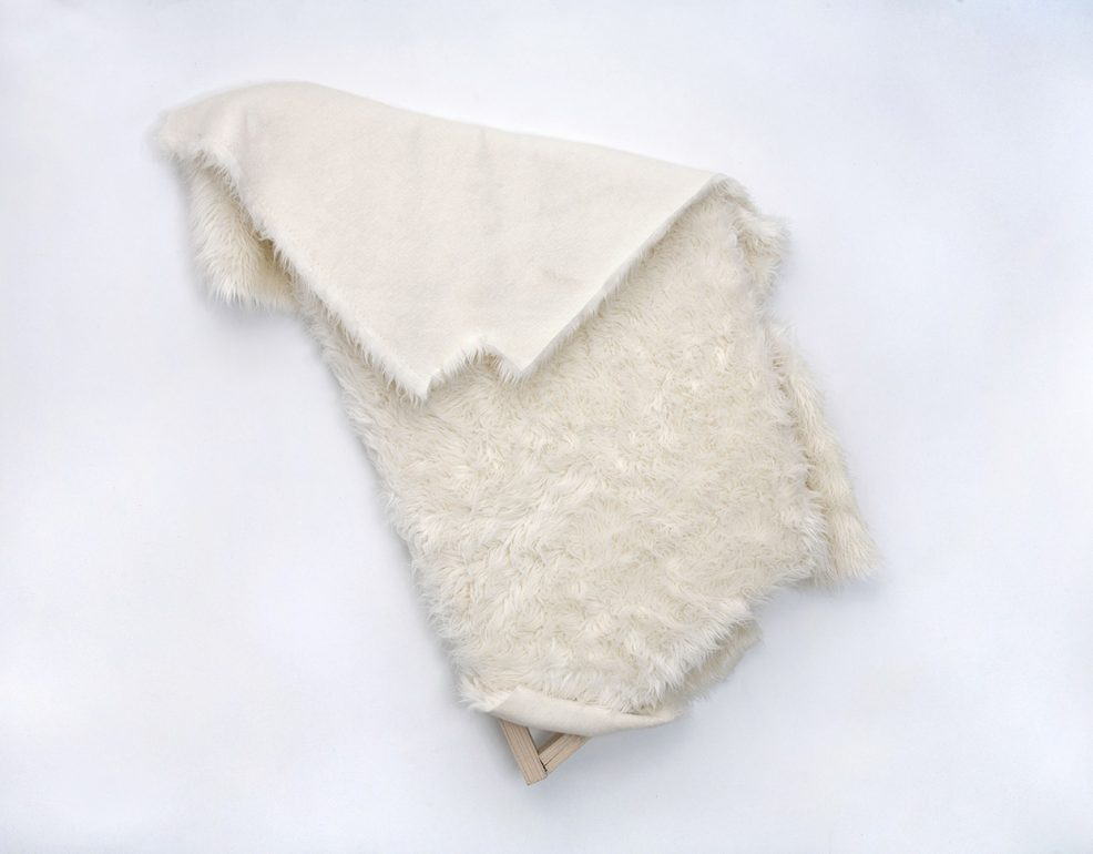 folded white fur trapezoid wall piece