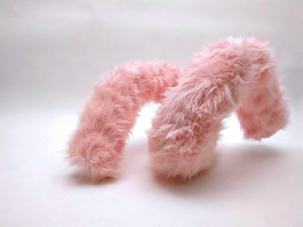 a synthetic fur pink curl sculpture