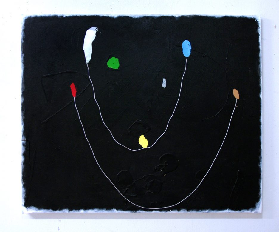 a black painting with white edge and spots of color linked by string