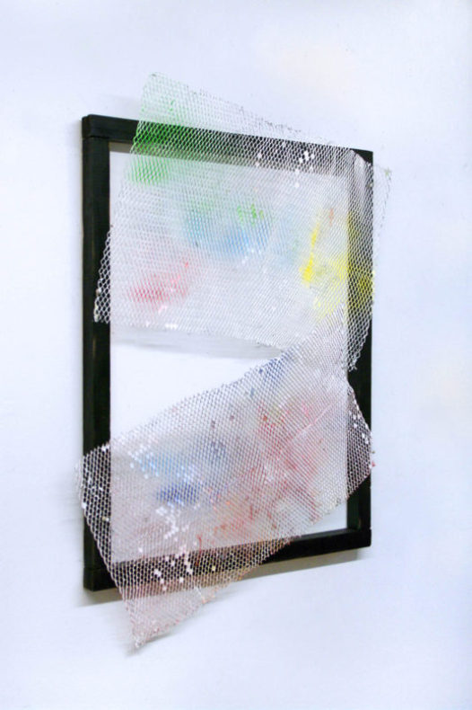 art piece with black wood frame with two colored metal sheets