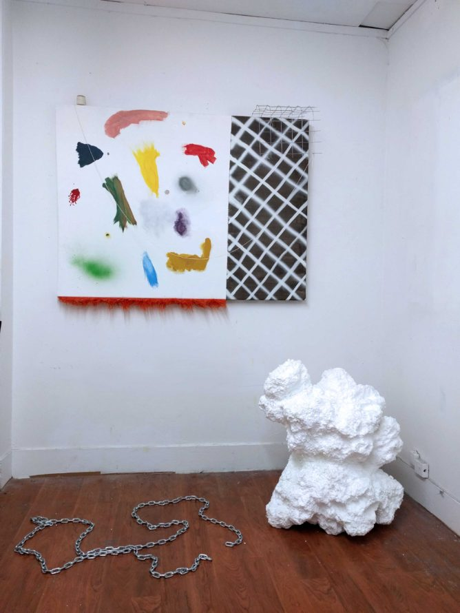 composition of 3 pieces, one styrofoam, one chain and one colorful mixed media piece