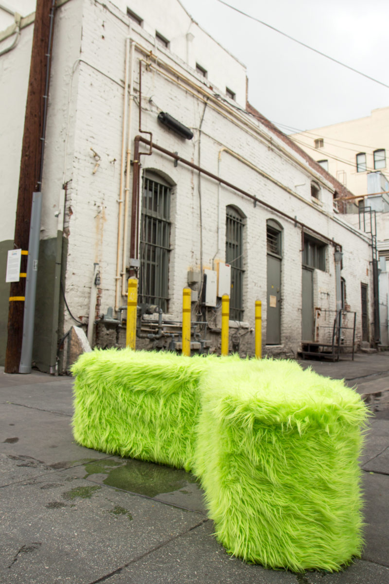 a green fur angled bench